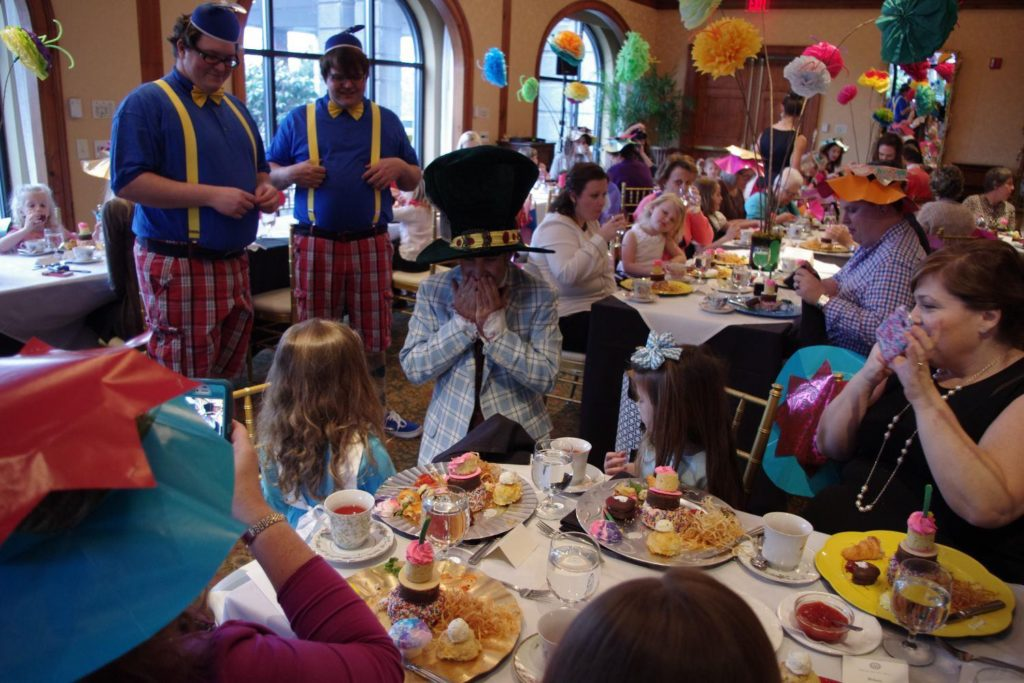 Mad Hatter and Guests at Mad Hatter Tea at O.Henry Hotel
