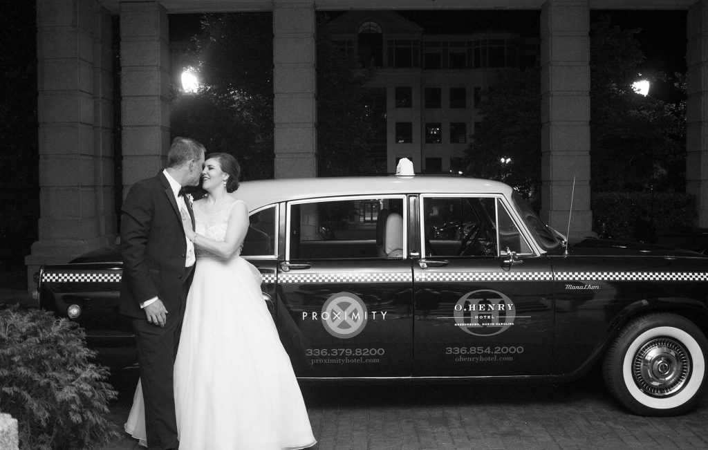 Weddings at O.Henry Hotel with Stephanie and Tim's pose for a London Taxi Departure
